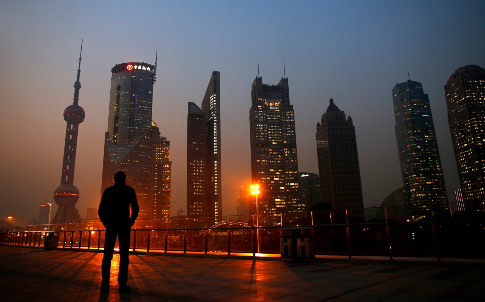 CARLOS BARRIA / REUTERS The Pudong financial district of Shanghai, November 2013