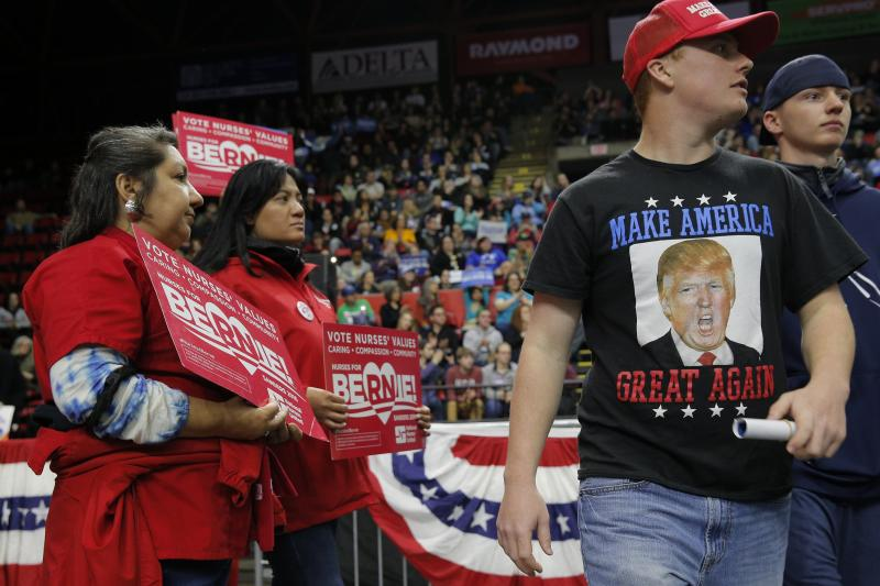 BRIAN SNYDER / REUTERS A Trump supporter leaves a rally for Democratic primary candidate Bernie Sanders in New York, April 2016.